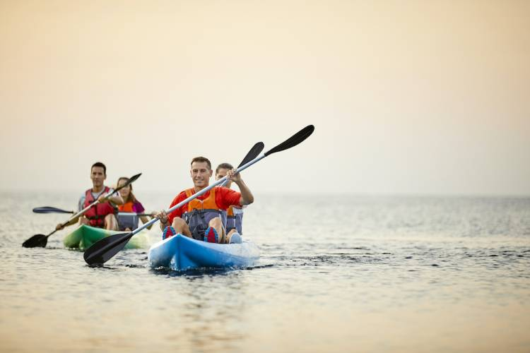 A family spends the day kayaking